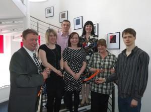 Cutting the Ribbon (from left Richard Ibbotson, Claire Nichol, Matthew Day, Jill Murdoch, Cathy Steedman, Ann Barrett and Ian Barrett)